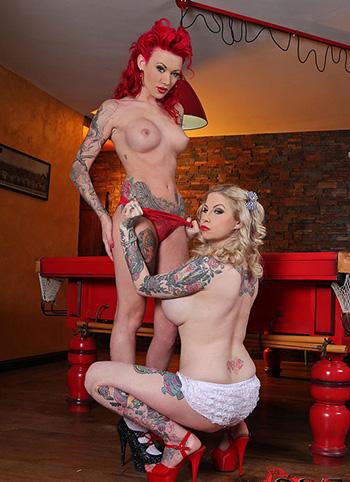 Two tattooed lesbians