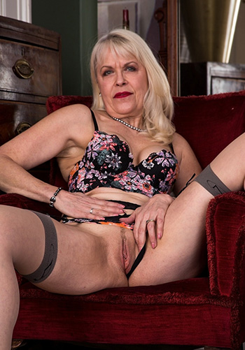 Margaret Holt takes off her black dress