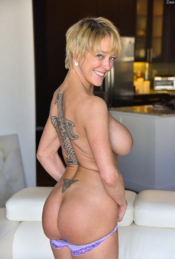 MILF Dee displays her fake tits